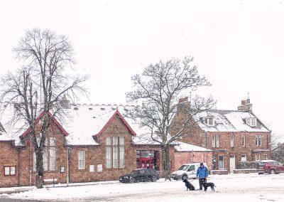 Village hall in snowstorm, 2020