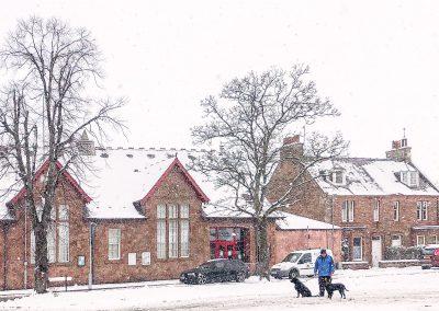 Village hall in snowstorm, 2020 wider